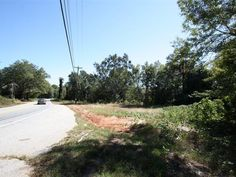 6.89 acres zoned RS.  Hop right on Wade Hampton and scoot to Greenville or Greer