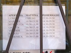Hours of operation of a clothing shop in Rome. July 2013
