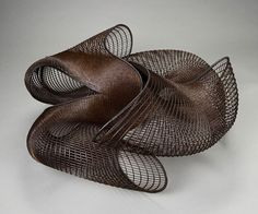 Basketry, Honda Syoryu, Artist, Galaxy, 2001, Bamboo (madake) and rattan,   openwork twining, H. 11 1/2 in x W. 25 in x D. 24 in., Lloyd Cotsen Japanese Bamboo Basket Collection,   Photograph by Kaz Tsuruta