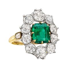 Victorian emerald and diamond cluster ring, centering on a natural square emerald-cut emerald weighing 2.20 carats (AGL-certified: natural with insignificant clarity enhancement, Colombian origin), accented by a graduated old mine cut diamond surround with smaller old mine cut diamonds at either shoulder of the hoop, the diamonds weighing approximately 2.80 total carats, circa 1900, mounted in 18k yellow gold and platinum.