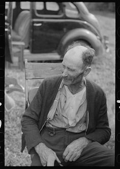 An old farmer at Sparlin's auction sale, Orth, Minnesota. By Photographer Russell Lee, 1903-1986