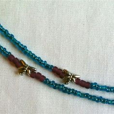 #waistbeads #keffigal #rootsnculture Single Strand: Single Strand: Blue, Yellow and Purple seed beads with dragon fly pops!