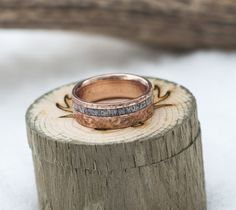 Gold wedding ring with elk antler inlay and hammered finish.