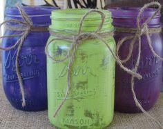jute twine on painted mason jars --- teal jar, white and purple daisies