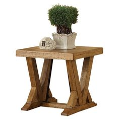 Angled trestle-base end table with a distressed finish.   Product: End tableConstruction Material: Pine solids, veneers and metalColor: Pine Dimensions: 24 H x 26 W x 24 D