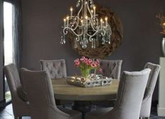 Like everything about this, the colour on the wall, chandelier, table and chairs.