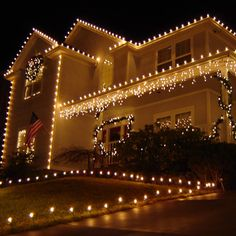 """Re-creating this look is a lot easier, and cheaper than you might think!   Decorating this home only took about 5-6 hours, with these items: (11) Clear C9 Light Sets, 25 Lights/Set (3) All Purpose Light Clips, 100pk (2) All Purpose Light Stakes, 25pk (1) 9' Pre-lit Garland (1) 45' GE Pre-lit Garland (1) 36"""" Snowbird Pre-lit Wreath  Light up a smile this holiday season with your home display!"""