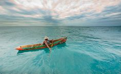 Photo of the Day: A man in a traditional boat in...
