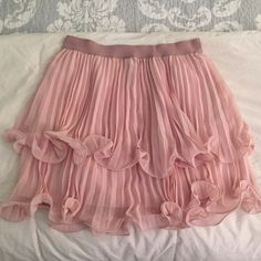 "BCBGMAXAZRIA pleated ruffle skirt So adorable and flowy with two layers of sheer ruffle and fully lined. Elastic waist that is very giving for a soft silhouette. Waist ranges from 28"" to 40"". Liner is 16"" in length and the ruffle dangles two inches past that for a total of 18"". Very pale vintage pink, more peach in color than it looks in the pics. BCBGMaxAzria Skirts A-Line or Full"