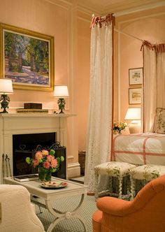 Decorating Tips from Interior Designer Gary McBournie - Traditional Home®  Love the stools at the end of the bed as a bench