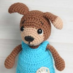 This is Timmy, an adorable amigurumi dog dressed in baby jumpsuit, looking for cuddles! Use our Timmy Dog Amigurumi Pattern to crochet your own dog cutie!