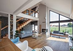 Modern single-family home in Poland. Architects/Builders: DOMY Z WIZJA Design Studio Rustic Home Design, Cabin Design, Small House Design, Dream Home Design, Home Interior Design, Interior Architecture, Modern House Facades, Modern Farmhouse Plans, House Stairs