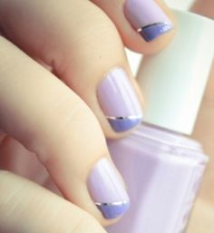 If you want something different for your nails this Summer opt for a minimalistic look. Choose pastel colors like lavender for the base shade. Add a hint of silver by drawing a diagonal line or creating a french manicure. Clean, simple and elegant.