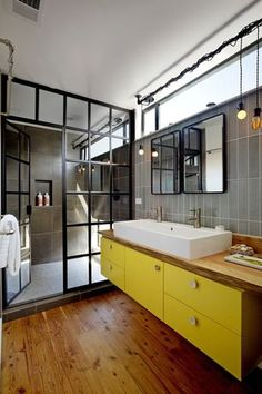 Eclectic Master Bathroom with Gridscape Shower Doors, Vessel Sink, Deck mounted double vessel sink - white, European Cabinets