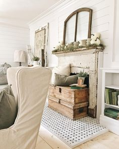 Paint daddy's blue bookcase and add next to fireplace when we move sideboard and decorate fireplace this way too