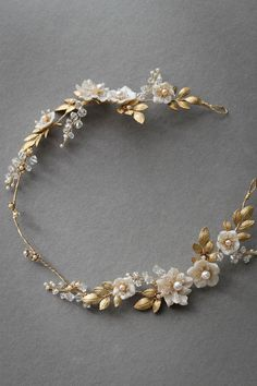 A stunning floral bridal halo featuring golden leaves and handcrafted floral accents. Perfect for a whimsical wedding or a bride seeking classic styling.