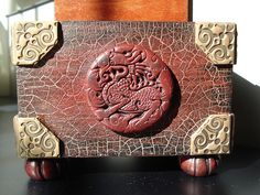 asian_box002 by gom6699, via Flickr ... wooden box with polymer clay embellishments before applying Swellegant brass coating + darkening + tiffany green/rust patina on the corner decorations
