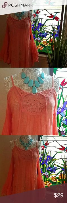 Peach Gauze Ladies Peasant Blouse This sweet and whimsical peach gauze peasant blouse is light, airy and adorned with crochet work on the front and back.  Perfect for a fun evening out or lunch with the girls!  Never worn and in pristine condition. Made in India and purchased at a clothing boutique.  Necklace is not included. Raviya Tops Blouses