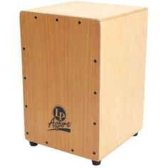 Latin Percussion LPA1331 Cajon Textured seating surface by Latin Percussion. $110.00. The LP Aspire Cajon houses a set of wire snares for vibrant flamenco trills and rich bass tones. The durable plywood front panel is adjustable with varying screw tension. Large rubber feet keep the cajon in place during play.