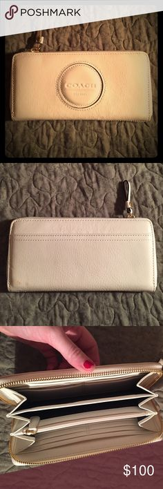 Ivory Coach Wallet Style F46468 Wallet measures about 8.5 inches wide and 4 inches tall. The wallet does match the ivory purse in my closet, but is also easy to put with any purse. The wallet is in pristine condition - it's never been used and the tag is located inside. It opens up according Style with 6 small pockets and 1 large pocket on either side, a large pocket in the middle and a zipper compartment. I'm happy to combine both Purse and wallet if you're looking for both! Coach Bags…