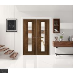 Seville Walnut Unglazed Door Pair  Seville Walnut Unglazed Door Pair     The Seville internal door pair will a touch of elegance to any interior.  The clean and bold lines give this flush door pair an unmistakable style that will transform the look of any modern styled home.    • Real American black walnut veneer  • Crown cut veneer  • 32mm can be taken off the width and height of the door  • Solid core  • Prefinished  • Unglazed  • FSC certified    We aim to dispatch all orders within 48…