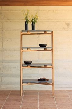 Merging technology with skilled craftsmanship, the Bookshelf A1 features a wooden skeleton frame that supports shelves appearing to float mid-air.