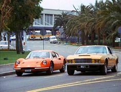 Still from The Persuaders TV series, early 70s - Aston Martin DBS and Ferrari 246 GT Dino