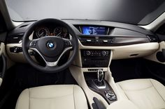 BMW X1 interior. Black and suede. Clean and  perfect with the new car smell!