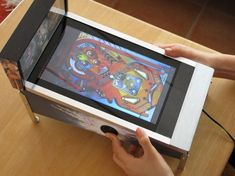 Mini pinball machine, made of an Android tablet, and arcade buttons