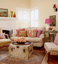 Cute Livingroom for small space. Check out those interior shutters.