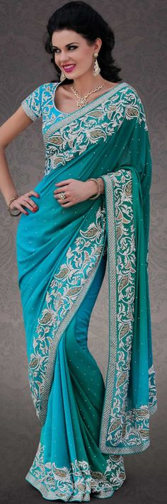Dreamy variation on shape and forms compliment your style with tradition. This turquoise and blue georgette saree is nicely designed with embroidery patch work is done with stone and cutbeads work. Beautiful embroidery work on saree make attractive to impress all. This saree gives you a modern and different look in fabulous style. Matching blouse is available. Slight color variations are possible due to differing screen and photograph resolution