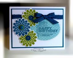 """Delightful Dozen, Button Buddies  Paper:  Island Indigo, Whisper White, In Color DSP  Ink:  Island Indigo, Lucky Limeade  Accessories: ruffled ribbon, designer button, mini brads  Tools:  piercing tool and mat, scallop circle punch, Big Shot, oval die cut, Itty Bitty Shapes punch, 1/2"""" circle punch"""