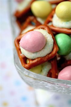 Peanut Butter Buttons    50 mini-pretzels **I used Hanover's Butter Snap…oh.my.gosh.    1 cup white candy melts, melted**Use your microwave and stir every 10 seconds or so after heating to make sure they melt completely    50 Reeses Pieces pastel eggs    Pastel sprinkles, for garnish