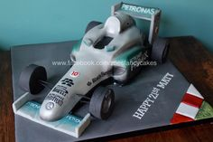 Racing car formula one cake - more at https://www.facebook.com/zoesfancycakes