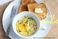 Curry and Comfort: 2 Minute Microwave Mug Omelet | Omelette in a mug    Spare yourself dirty pans with a yummy one-serving breakfast omelette. Mix your fillings—veggies, meat, cheese or fruit, chocolate, what have you—in a greased mug with a beaten egg and a little milk. Wait two minutes or so for the microwave to do its job, then grab your fork.    Read more: http://www.rd.com/slideshows/cake-in-a-mug-and-more-mug-recipes/#ixzz2U5pAI1wS