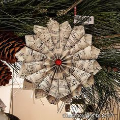 Sheet music paper medallion ornaments available at Southbank Gift Co. #glascockgifts #southbankgifts #christmas #ornaments #handmade #handmadechristmas #paper #papermedallions #paperart #openhouse