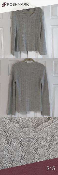"""Ann Taylor silver cashmere sweater 86% cashmere 10% metallic silver 4% other.   Dry clean. Scallop design at neck photo 3.  Shear design but not see-through. Silver threads throughout entire sweater. Armpit to armpit is 19"""". Shoulder to bottom hem is 26"""".  Shoulder seem to cuff is 27"""". Beautiful sweater worn once. Ann Taylor Sweaters Crew & Scoop Necks"""