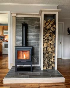 This is probably my favorite house project to date. Dave and I bought ourselves a wood stove for Christmas. It took me 3 weekends to build… Wood Stove Surround, Wood Stove Hearth, Wood Stove Wall, Stove Fireplace, Corner Wood Stove, Future House, My House, Cabana, Home Projects