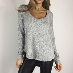 "• Last Item • Softest Grey Sweater Top L Uber luxe and soft lightweight sweater long sleeve top. Feels much like a cashmere blend. Gorgeous marbled light heather grey. Flattering scoop neckline with a longer hemline in the back. Another must have basic for the season. 96% Poly 4% Spandex. Size M measures 25"" across chest 27"" front length 30"" in the back. I am wearing Size S. Boutique Tops Tees - Long Sleeve"