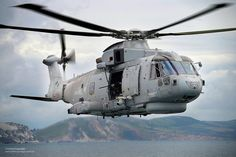 A Royal Navy Merlin helicopter taking part in an exercise over the south of England. Military Helicopter, Military Aircraft, Marine Royale, Augusta Westland, Search And Rescue, Royal Navy, Armed Forces, Merlin, Fighter Jets
