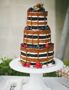 Naked chocolate cake with berries.