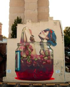 i really like this piece of street art I think if I did my own version I would put one of her legs out of the jar so it drips the juice I think that'd make it a little sexier
