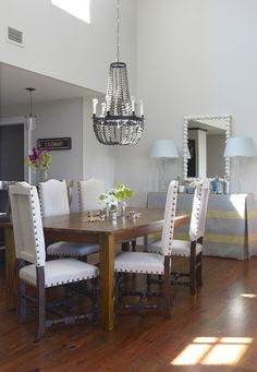 Contemporary Beach Condo Dining Room With Two Story Ceiling And Gray Beaded Chandelier Lamp