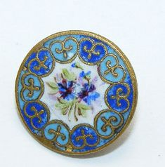 Antique enameled buttons. Hand painted enamel floral spray. Gold tone metal. Later Victorian era or possibly the early 1900s.