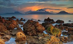 Sunset and rocks -- Saria Beach, Halmahera Island, North Maluku, Indonesia