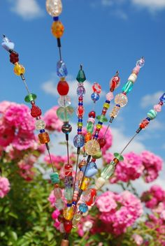 Garden Bead Art. Can't believe the price tag on this.  Get 3 whisks for $2. at walmart . cut apart, add beads .    That's it.  Easy Peasy.