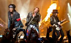 Motley Crue, Nikki Sixx, Vince Neil and Mick Mars on the Right, Tommy Lee on Drums