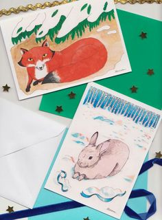 Hand illustrated pack of 8 Christmas cards featuring a fox and a rabbit of each design). They are in size and come with white size. Fox And Rabbit, Hand Wrap, Hand Illustration, Envelopes, Christmas Cards, Packing, Pearl, Number, Unique