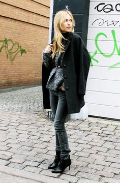 Look De Pernille goes for a casual jeans and spotted sweater combo, adding some polish with a waist belt