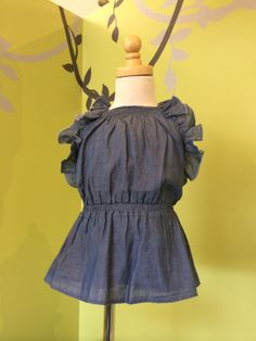 2014 Spring/Summer Kids Apparel Collection. Chloe denim dress with ruffled detail.